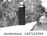 a covered drinking water bottle ...   Shutterstock . vector #1427121944