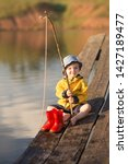 A Little Boy Fishing And Wants...