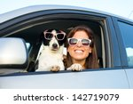 Woman And Dog In Car On Summer...