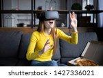 beautiful woman touching air... | Shutterstock . vector #1427336021