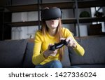cute girl plays the game on the ... | Shutterstock . vector #1427336024