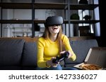 cute girl plays the game on the ... | Shutterstock . vector #1427336027