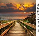 boardwalk on beach at sunrise | Shutterstock . vector #142734964