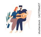 lovely couple sitting on bench...   Shutterstock .eps vector #1427396657