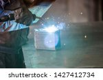 worker in a protective wardrobe ...   Shutterstock . vector #1427412734