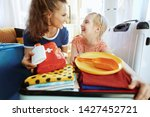 happy young mother and child...   Shutterstock . vector #1427452721
