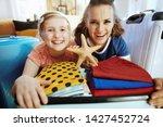 happy trendy mother and...   Shutterstock . vector #1427452724