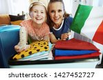 happy trendy mother and...   Shutterstock . vector #1427452727