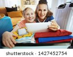 smiling young mother and...   Shutterstock . vector #1427452754