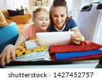 happy trendy mother and child...   Shutterstock . vector #1427452757