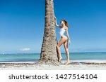 pretty woman white swimsuit...   Shutterstock . vector #1427514104