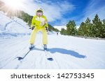 Happy Young Woman Skier In...