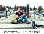 handsome man posing in the...   Shutterstock . vector #1427541401