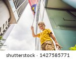 young boy tourist with the flag ...   Shutterstock . vector #1427585771