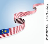 malaysian flag wavy abstract... | Shutterstock .eps vector #1427682617