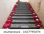 Steps lead into the distance lined either side with poppy wreaths in Ypres.Belgium - Image