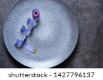 empty plate with a tape measure ... | Shutterstock . vector #1427796137