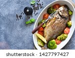 baked dorado with spices  with... | Shutterstock . vector #1427797427