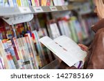 woman reading a magazine which...   Shutterstock . vector #142785169