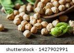 uncooked dried chickpeas in... | Shutterstock . vector #1427902991