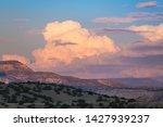 Sunset Paints Cumulus Clouds...