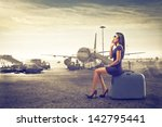 beautiful woman waits sitting... | Shutterstock . vector #142795441
