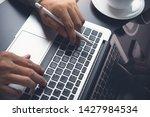close up of business man hands... | Shutterstock . vector #1427984534