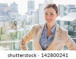 happy businesswoman looking at...   Shutterstock . vector #142800241