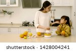 asian young mother is drinking... | Shutterstock . vector #1428004241