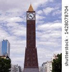 Small photo of May 29 2019: Tunis Tunisia: The clock tower is an unusual steel monument with fountain. Nearby the helpful Tunis visitor information center. Tunis Tunisia.