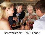 group of friends enjoying meal... | Shutterstock . vector #142812064