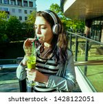 young pretty woman using... | Shutterstock . vector #1428122051