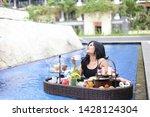 happy women drinking breakfast... | Shutterstock . vector #1428124304