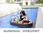 drinking coffee breakfast in... | Shutterstock . vector #1428124367