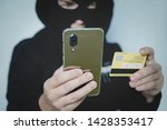 Cyber Criminal In Balaclava...