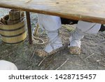 the feet are shod in an old... | Shutterstock . vector #1428715457