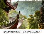 Grand ancient roof architecture of main hall of Lingyin Temple Buddhist monastrery among green forest, Hangzhou - China