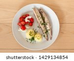 Stock photo mackerel fish dish with potatoes chives and tomato salad top view of plate fatty oily fish is 1429134854
