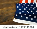american flag on a old wooden... | Shutterstock . vector #1429145504