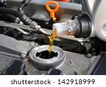 Small photo of Motor oil, car engine close up