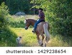 cowgirl horseback riding at... | Shutterstock . vector #1429238654