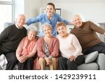 Young Caregiver With Group Of...