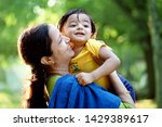 Happy Mother Holding Adorable...