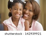 mother and daughter smiling for ... | Shutterstock . vector #142939921