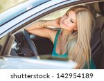 happy young woman in car... | Shutterstock . vector #142954189