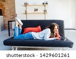 Woman Lying On A Sofa Using A...