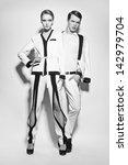 fashion couple in white suite | Shutterstock . vector #142979704