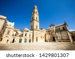 Basilica Church of the Holy Cross. Lecce, Italy. Square of the famous basilica Church of the Holy Cross. Historic city of Lecce, Italy. Blue sky.