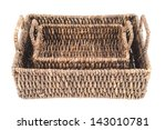 Composition of two brown wicker baskets, box shaped, isolated over white background, top view - stock photo