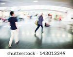hurried people at a railway station in motion blur - stock photo